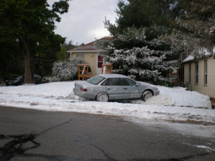 car  crashes into snow bank with fake snow blankets